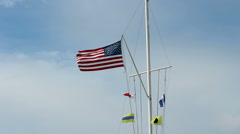 United States And Nautical Flags On Pole Blue Sky Stock Footage