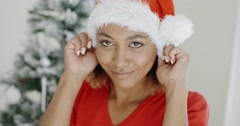 Attractive young woman donning a Santa hat Stock Footage