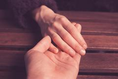 Lover's holding hands - stock photo