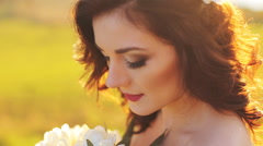 Emotional touched beautiful brunette bride in white dress in wreath with make-up Stock Footage
