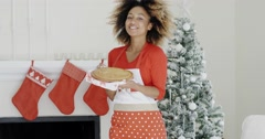 Happy trendy young woman with a Christmas dessert Stock Footage