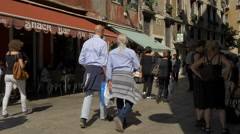 Men and women walking in Campiello Santo Stefano, Venice Stock Footage
