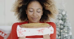 Young woman with a fresh Christmas tart Stock Footage