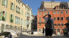 One man taking pictures in Campiello San Vidal in Venice Stock Footage