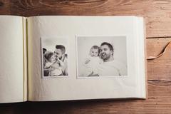 Photo album with pictures - stock photo
