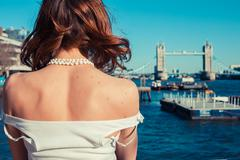 Young woman admiring the River Thames Stock Photos