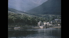 Vintage 16mm film, 1965, pan of Loch Duich near Eilean Donan castle Stock Footage