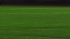 Female soccer players pass the ball during a game at night and make a goal - stock footage