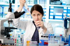 Laboratory assistant analyzing a blood sample Stock Photos
