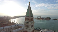 Aerial view of St Mark's Clocktower and the beautiful Venetian Lagoon in Venice Stock Footage