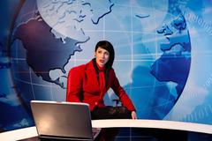 Woman sitting in tv studio - stock photo