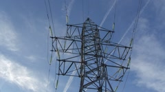 metal electricity pylon against the sky with vapor trail from the plane, metal s - stock footage