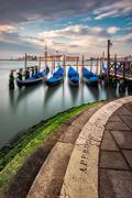 Italy, Venice, Blue gondolas in water - stock photo