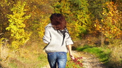 Woman running on the path with bouquet of briers, steadycam shot, slow motion sh Stock Footage