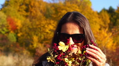 Woman holding bouquet and playing with brier, steadycam shot, slow motion shot a Stock Footage