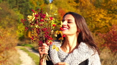 Woman going round and holding bouquet of briers, steadycam shot, slow motion sho - stock footage
