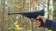 Gun Shooting. Forest in a background Stock Footage
