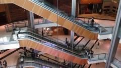 Escalators inside a shopping mall Stock Footage