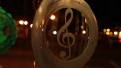 Golden treble clef turning slowly - stock footage