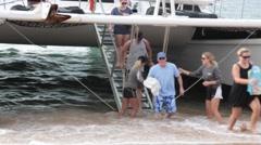 People leaving catamaran ship, tropical envoronment Stock Footage