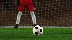 Stock Video Footage of Close up of a soccer player making a penalty kick and shooting it too high