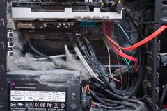 The main components of the outdated, dusty and non-working computer, supply and - stock photo