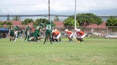 Teen Football players running Stock Footage