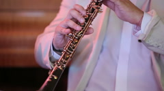 Musician playing the oboe Stock Footage