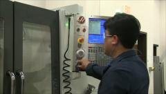 CNC machinist setting up milling machine - stock footage