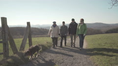 active seniors walking and chatting in rural landscape - stock footage