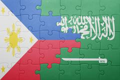 Puzzle with the national flag of saudi arabia and philippines Stock Photos