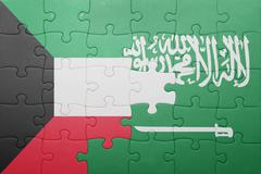 puzzle with the national flag of saudi arabia and kuwait - stock photo