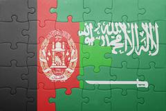 puzzle with the national flag of saudi arabia and afghanistan - stock photo