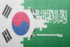 puzzle with the national flag of saudi arabia and south korea - stock photo