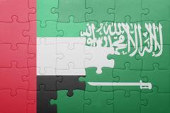 puzzle with the national flag of saudi arabia and united arab emirates - stock photo