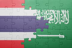 Puzzle with the national flag of saudi arabia and thailand Stock Photos