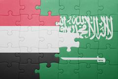 puzzle with the national flag of saudi arabia and yemen - stock photo
