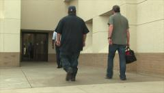 Students and Workers Enter Building - stock footage