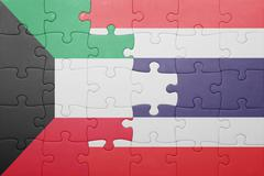 puzzle with the national flag of thailand and kuwait - stock photo