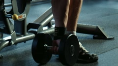 The bodybuilder does exercise with dumbbells Stock Footage