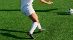 A female soccer player slide tackles an opponent during a game Stock Footage