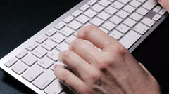 Typing on the wireless keyboard with mouse Stock Footage