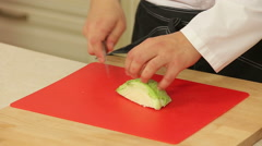 Chef cutting green cabbage Stock Footage