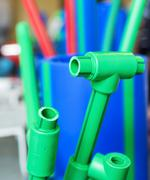 Polymer pipes and fittings - stock photo