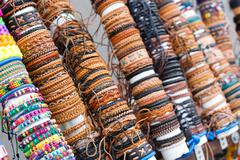 Many various leather and textile bracelets - stock photo