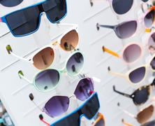 Rack with sunglasses Stock Photos