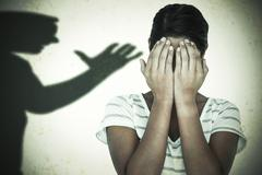 Composite image of close-up of upset woman covering face with hands - stock photo