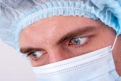 Serious doctor's glance Stock Photos