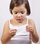Cute girl with a clinical mercury-in-glass thermometer - stock photo