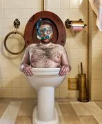 Bizarre man in vintage toilet Stock Photos